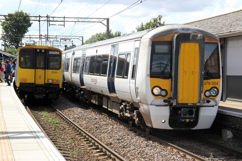 Greater Anglia's 30 new Class 379 Electrostar units are used on West Anglia Main Line services. Here, 379004 forming 2H26, 1153 London Liverpool Street to Cambridge passes 315854 at Seven Sisters on 26th August 2012.