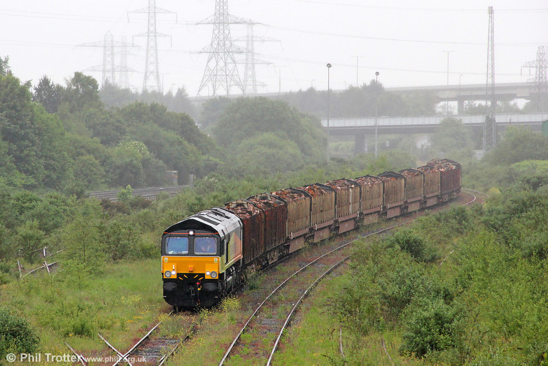 Colas Rail's 66846 pulls into Briton Ferry Yard to run around its train, 6Z51, 1600 Baglan Bay to Chirk (Kronospan) on 5th June 2012.