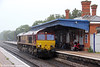 66250 gives the impression that it is attempting to shelter froim the rain as it runs light through Cholsey from Hinksey Yard to Eastleigh on 14th July 2012.