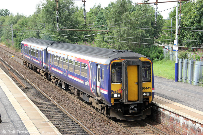 Displaying the previous version of First Scotrail livery, 156449 passes Holytown forming 1Y86, 1405 Glasgow Central to Edinburgh Waverley on 6th August 2012.