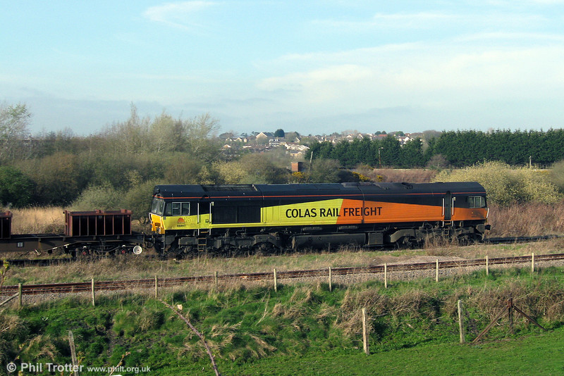 Colas Rail 66847, on hire to DBS, departs from Trostre Works with 6B20, 1735 Trostre to Margam on 30th March 2012.