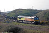 An inferior 'for the record' shot taken with a Canon A580 compact - the only available camera at that moment - showing Colas Rail 66847 leaving Trostre Works with 6B20, 1735 Trostre to Margam on 30th March 2012. The loco was on hire to DBS.