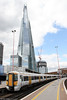 375609 at London Bridge with the giant Shard as a backdrop, forming 1H42, 1353 Charing Cross to Hastings on 26th August 2012.