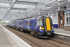 Scotrail operates 48 new Siemens Desiro class 380 units. 22 are in three car (class 380/0) formation, with a further 16 four car units (class 380/1); the type is used mainly on the Ayrshire Coast and Inverclyde lines. 380003 calls at Paisley Gilmour Street - now with a new £9m overall roof as part of the Paisley Corridor Improvement Project - forming 2G36, 1523 Gourock to Glasgow Central on 5th August 2012.