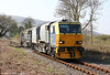 Spring means that it's weedkilling season once again. Network Rail's Windhoff MPV DR98959 and DR98909 are seen at Garnswllt running as 6Z10, 0904 Margam to Llanwrtyd Wells and return on 1st April 2012.