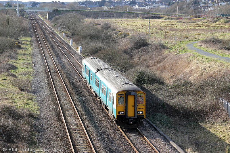 Engineering work on 4th March 2012 meant that services to West Wales were somewhat limited, with replacement buses taking the place of several trains. 150264 approaches Pwll with 1E13, 1423 Fishguard Harbour to Llanelli.