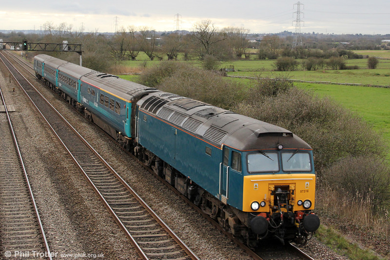 57316 passes Coedkernew with 1W91, 1615 Cardiff Central to Holyhead on 20th March 2012.