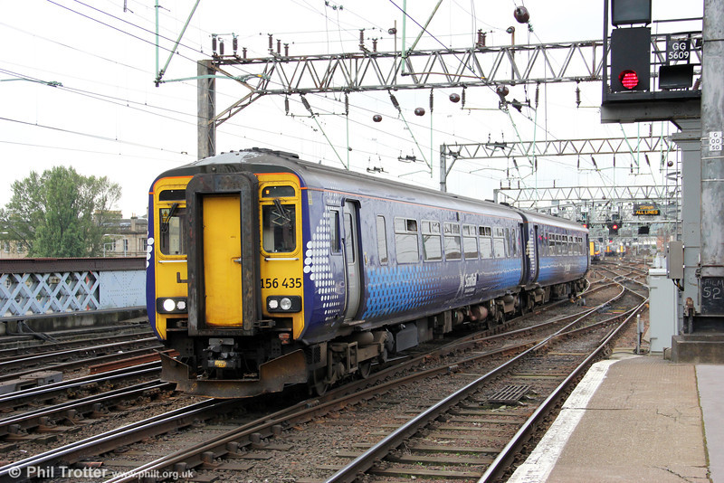 One of Scotrail's fleet of 48 class 156s, 156435 rolls into Glasgow Central forming 2A36, 0756 from Barrhead on 6th August 2012.