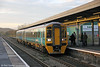158836 calls at Whitland forming 1W35, 1530 Milford Haven to Manchester Piccadilly on 11th November 2012.