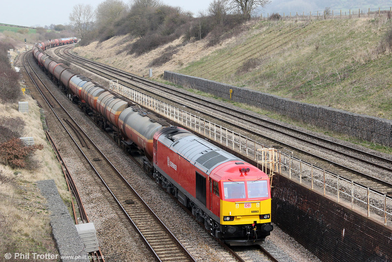 60063 heads south through Standish with 6B13, 0505 Robeston to Westerleigh on 22nd March 2012.