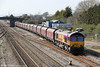 Lickey banker 66057 passes Magor with 4F70, 1222 Aberthaw to Avonmouth on 21st March 2012.