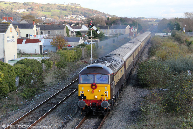 Carrying a wreath of poppies for Remembrance Sunday, 47832 'Solway Princess' passes Pembrey and Burry Port with 1Z35, 1222 Cardiff Central to Fishguard Harbour, the Northern Belle dining train on 11th November 2012.