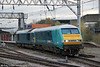 Staff familiarisation of the Arriva Trains Wales DVTs continues. Here, 82308 is propelled through Crewe by 67003 forming 5Z53, 1338 Shrewsbury to Holyhead on 7th November 2012.