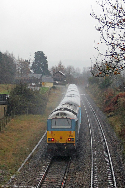 67003 gets a soaking at the rear of 'Rugex' 1V41, 0807 Holyhead to Cardiff Central as it passes Penpergwm on 24th November 2012.