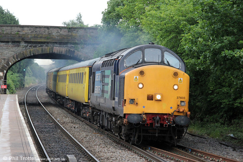 DRS 37603 roars through Yate heading 1Q13, 0930 Exeter Riverside Yard to Derby RTC on 16th June 2012. Classmate 37611 was at the rear.