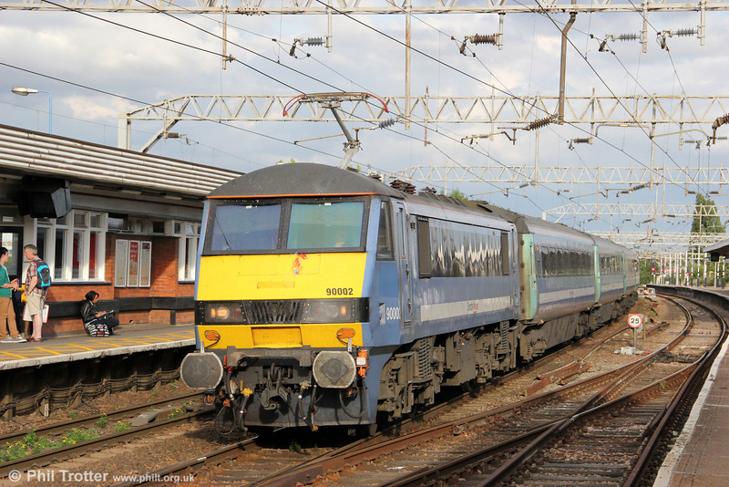 On one of the last bastions of regular loco hauled passenger services in the UK, using a fleet of 15 class 90s for Liverpool Street to Norwich services, Greater Anglia 90002 rolls into Colchester with 1P55, 1700 Norwich to London Liverpool Street on 26th August 2012.