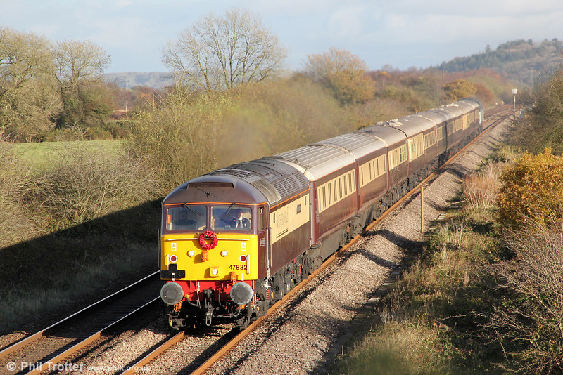 Carrying a wreath of poppies for Remembrance Sunday, 47832 'Solway Princess' passes Nantyrhebog with 1Z35, 1222 Cardiff Central to Fishguard Harbour, the 'Northern Belle' dining train on 11th November 2012. Classmate 47828 was at the rear. <br>As many as 25,000 British railway employees gave their lives in the two World Wars. <i>(Source: NRM)</i>