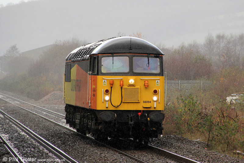 Having deposited timber wagons at Baglan Bay for loading in time for next week's run to Chirk, 56094 is seen running light through a very wet Pontyclun forming 0Z50, 1350 Baglan Bay to Cardiff Riverside on 23rd November 2012.