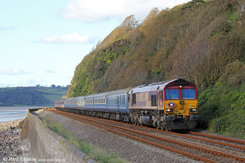 66067 heads along the sea wall at St. Ishmaels with Cheshire Cat Tours 1Z51, 1555 Carmarthen to Stratford-upon-Avon on 6th October 2012. This having been the first tour over the Central Wales Line since the passing of Tom Clift, esteemed railway director and preservationist, a wreath was carried in his memory.