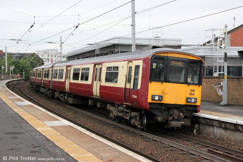 318254 calls at Partick forming 2F68, 0839 Balloch to Motherwell on 5th August 2012. The class 318 outer suburban units were built by BREL in the mid 1980s, originally for use on the newly electrified Glasgow to Ayr route.