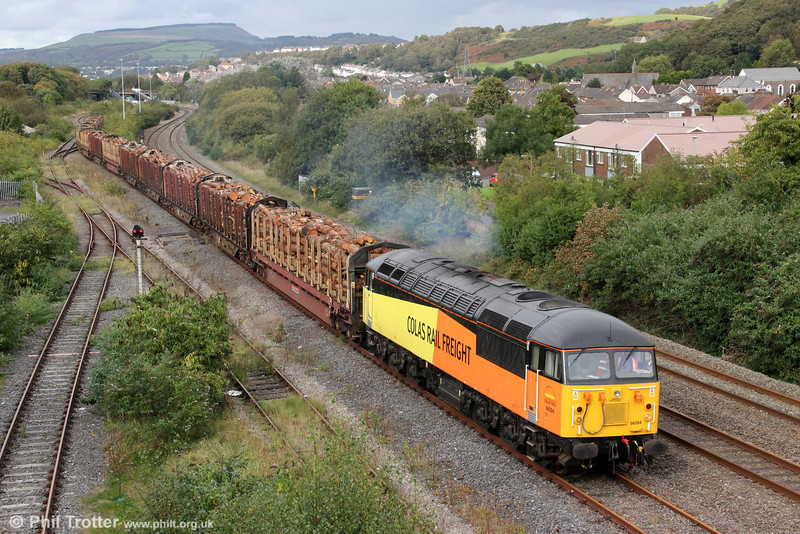 Colas Rail 56094 departs from Briton Ferry with 6Z51, 1600 Baglan Bay to Chirk (Kronospan) timber on 4th October 2012.