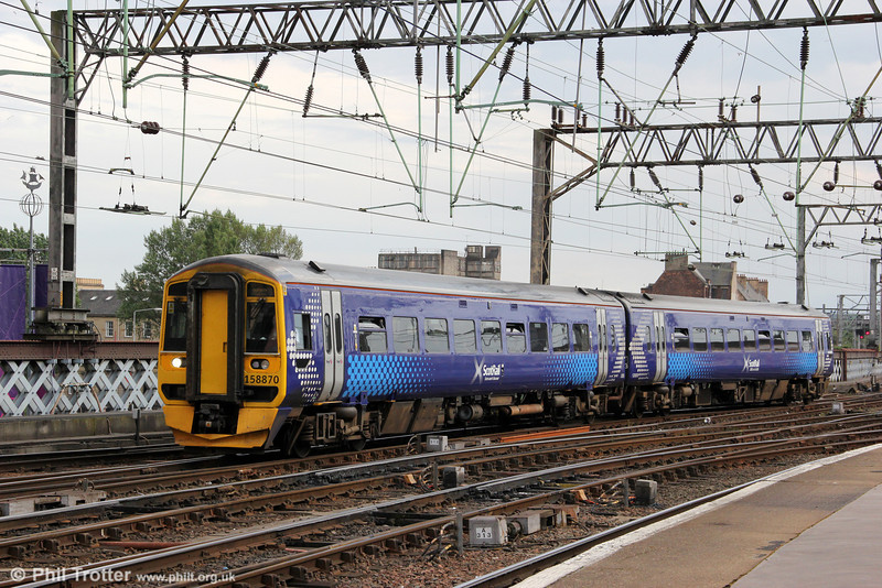 One of seemingly few class 158s so far repainted in the new Scotrail livery, 158870 arrives at Glasgow Central forming 2R03, 1706 from Whifflet on 4th August 2012.
