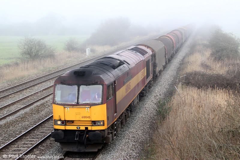 60045 'The Permanent Way Institution' passes Coedkernew with 6V05, 0910 Round Oak to Margam on 1st March 2012.