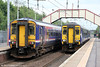 A comparison of old and new liveries as 156507 forming 2Y49, 1627 Edinburgh Waverley to Glasgow Central meets 156449 forming 2Y52, 1720 Glasgow Central to Edinburgh Waverley at Holytown on 6th august 2012.