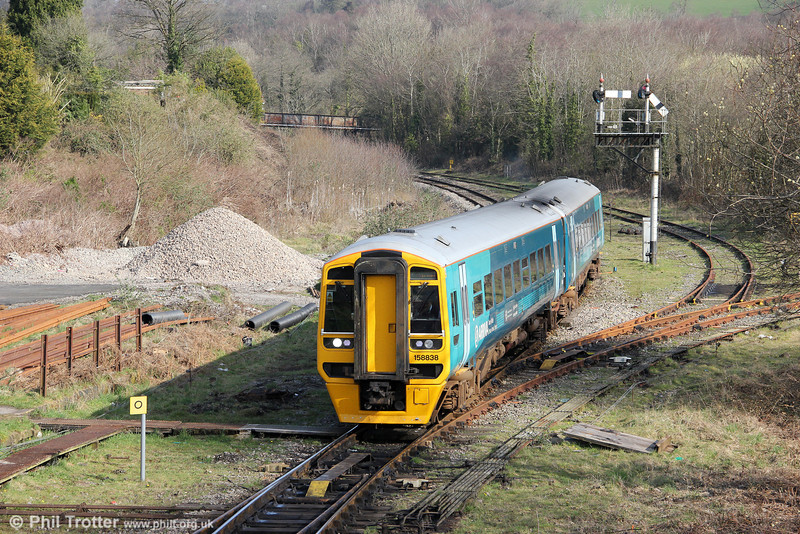Recently refurbished 158838 at Tondu forming 2G56, 0917 Maesteg to Cheltenham Spa on 24th March 2012.