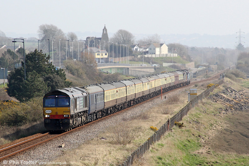 On the soon-to-be-redoubled section at Loughor, 66304 heads Pathfinder's 1Z66, 1036 Tondu to Cwmgwrach via GCG, 'The Coal Grinder' railtour on 24th March 2012.