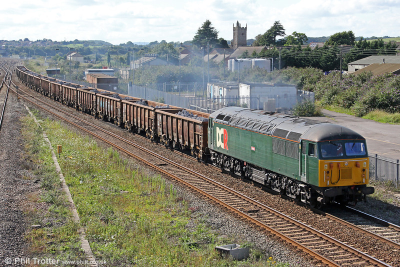 2012 is certainly proving to be 'comeback year' for the class 56s with both Colas and DCR now using them in traffic in the UK, while the Hungarian rail transport company Floyd also has taken some. DCR's 56303 (the former 56125) 'Brian' passes Severn Tunnel Junction with a retimed 6Z93, 1234 Cardiff Tidal to Masborough (Rotherham) carrying electric arc furnace slag from Celsa on 20th August 2012. The slag will eventually be used for road building.
