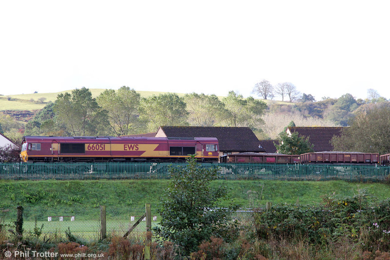 66051 waits west of Gowerton with a ballast train (6Y08) for the Cockett to Llandeilo Junction redoubling project on 13th October 2012.