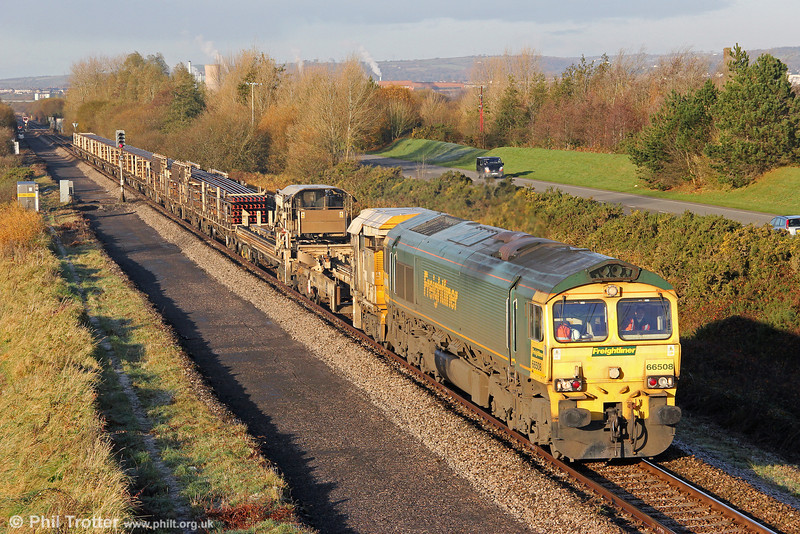 66508 passes Loughor with 6Y97, 0940 Llandeilo Junction to Westbury on 18th November 2012. As a consequence of unloading difficulties, the train is still carrying new rail. Note also that the trackbed has been cleared and prepared for the reinstatement of the down line.
