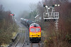60054 adds a little colour to an otherwise drab scene as it approaches Tondu with 6H25, 1034 Margam to Llanwern which had been heavily delayed due to adhesion problems on the little used line from Margam on 8th January 2012.