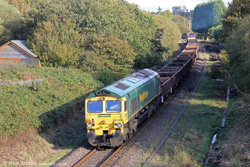 Freightliner locos are seldom seen west of Swansea. Here, 66560 brings up the rear of spoil train 6Y08, 1530 Gowerton to Crewe Basford Hall at Waunarlwydd on 14th October 2012. The train was headed by 66051.
