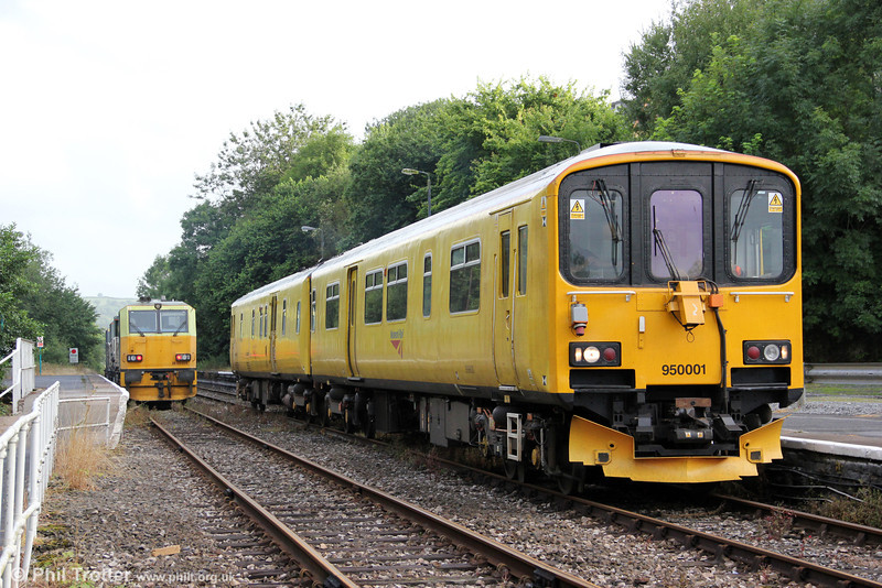 Network Rail out in force at Llandeilo: 950001 running as 2Q08, 0740 Llandrindod Wells to Llandrindod Wells via Clarbeston Road, Swansea, Newport ADJ and Llandeilo Junction crosses weedkilling MPV DR98959 and DR98909 running as 6Z10, 1015 Margam to Margam via Hereford, Craven Arms and Llandrindod Wells on 1st August 2012.