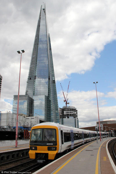 Opened earlier this year, The Shard is reputedly the tallest building in Western Europe, a mixed-use 1,016ft structure which includes offices, restaurants and a hotel. 465039 departs from London Bridge forming 2N40, 1356 Charing Cross to Gravesend on 26th August 2012.