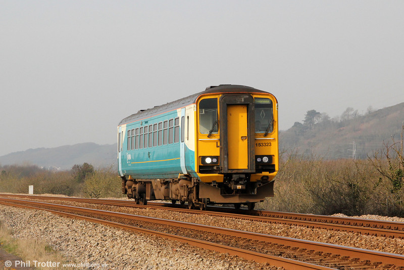 ATW 153353 ambles through Pwll in the spiring sunshine forming 2E09, 0909 Pembroke Dock to Swansea on 2nd March 2012.