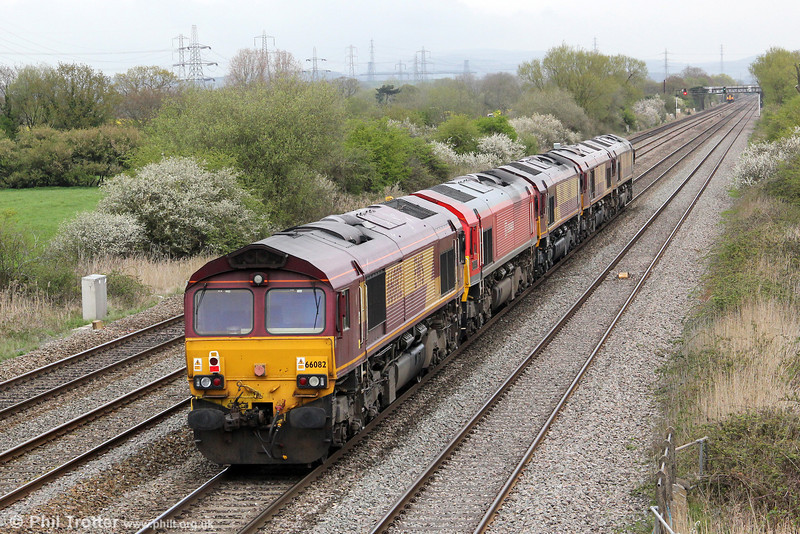 66082 brings up the rear of convoy, 0X12, 1106 Margam to Eastleigh at Coedkernew on 14th April 2012.