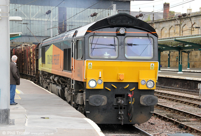 Colas 66848 passes through Carlisle with 6J37, 1244 Carlisle Yard to Chirk loaded timber on 7th August 2012.