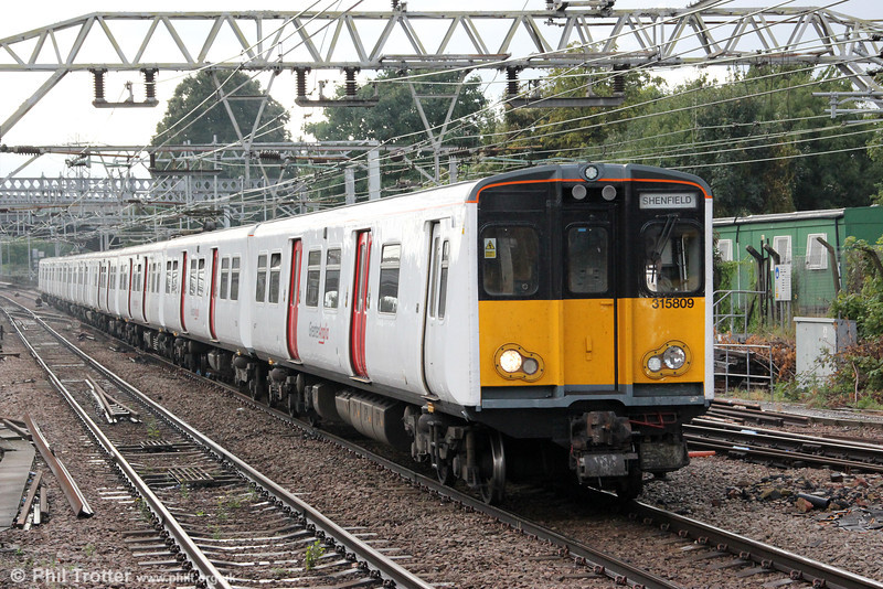 Refurbished with new headlight clusters and Greater Anglia livery, 315809 approaches Ilford forming 2W42, 1720 London Liverpool Street to Shenfield on 25th August 2012.