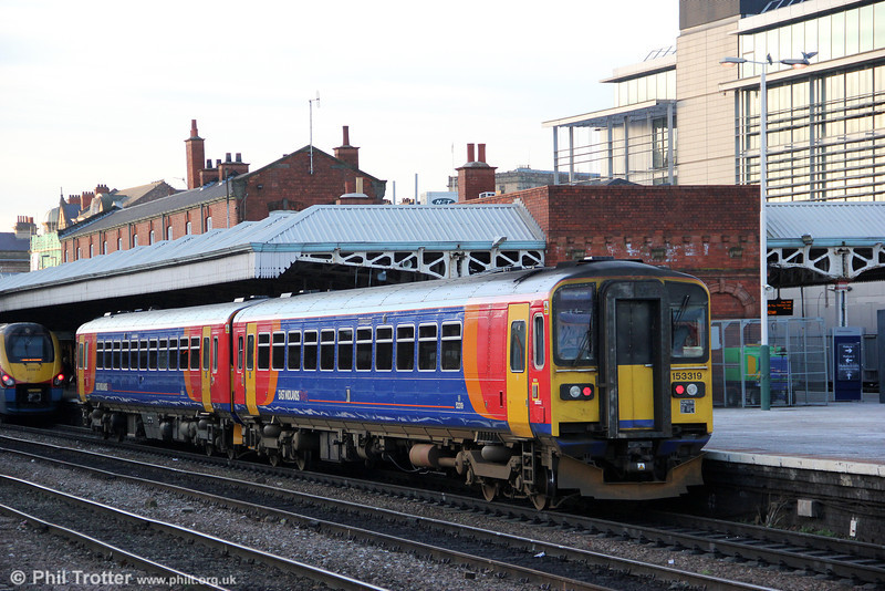 East Midlands 153319 and a classmate wait at Nottingham, ready to form 2S21, 1445 to Skegness on 29th November 2012.