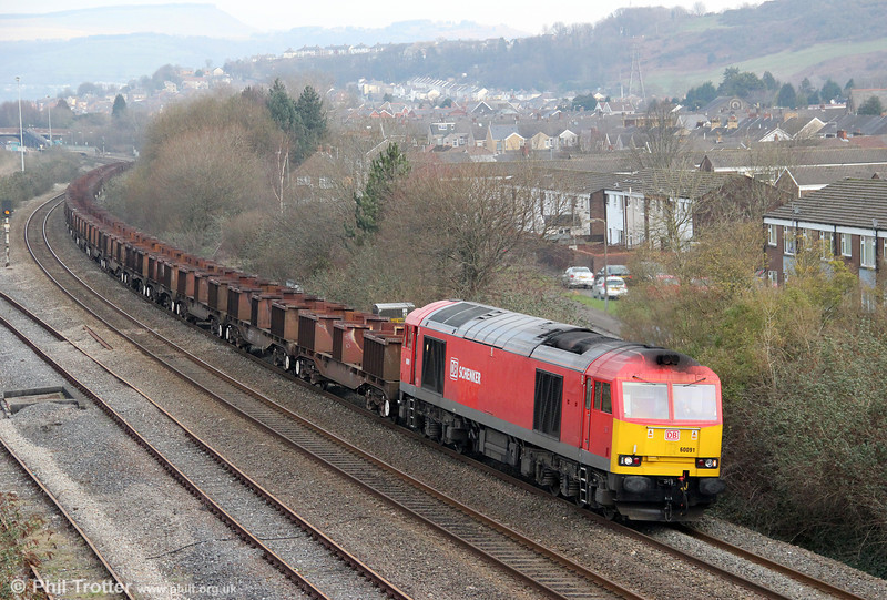 60091 passes Briton Ferry with a lengthy 6B03/6B67, 0910 Trostre Works to Margam and Llanwern empties on 11th February 2012.