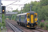 165513 perpares to call at Holytown forming 2Y42, 1814 Glasgow Central to Edinburgh Waverley on 6th August 2012.