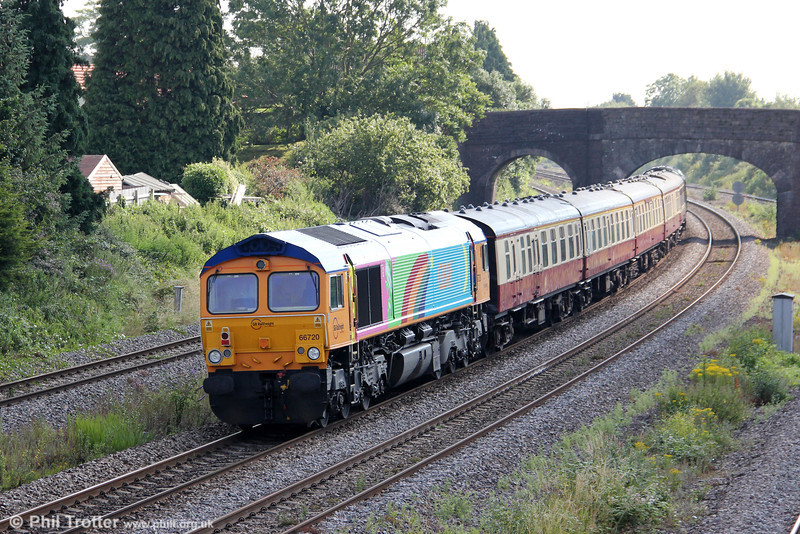 Rainbow liveried GBRf 66720 is seen at Undy bringing up the rear of GBRf staff charter 1Z50, 0915 Cardiff Central to Paignton on 21st July 2012.