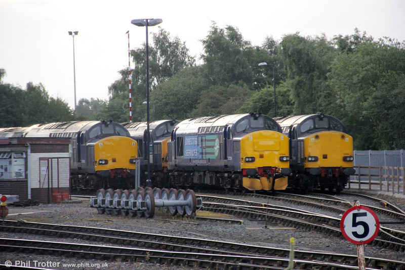 A brace of class 37s, including 37612 (left) and 37259 (centre) await their next jobs at Gresty Bridge, Crewe on 4th August 2012.