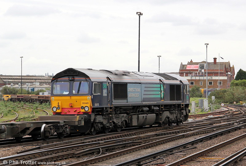 Freightliner's former DRS 66418 passes Eastleigh with 4O29, 08:4 Crewe Basford Hall to Southampton on 5th May 2012.