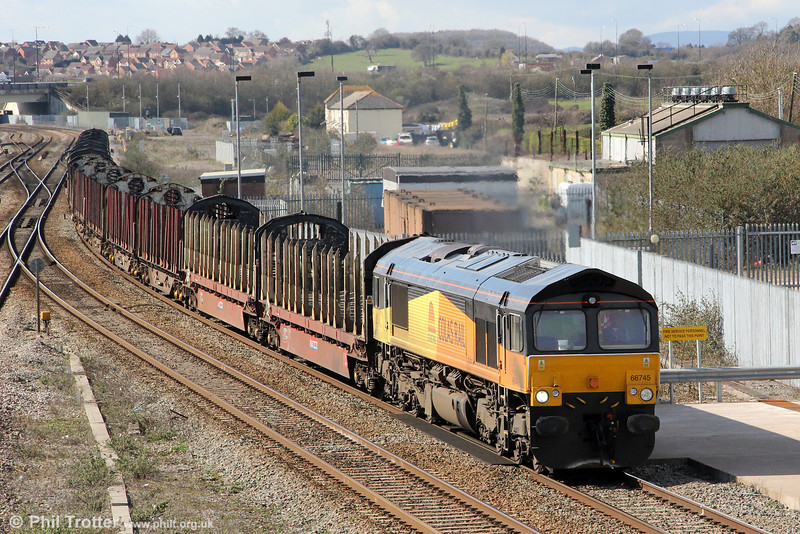 GBRf/Colas Rail 66745 is seen at Severn Tunnel Junction with 6Z50, 0913 Chirk to Teigngrace empty log carriers on 19th March 2012. 66745 has something of an identity crisis; previously numbered 66844 in the Colas fleet, the loco is now with GBRf, so its current number is in the GBRf sequence. It has yet to be repainted into GBRf livery and is on hire to Colas, still in their livery! Originally, the loco was new to DRS as 66409, but renumbered 66844 when it passed to the shortlived Advenza company.