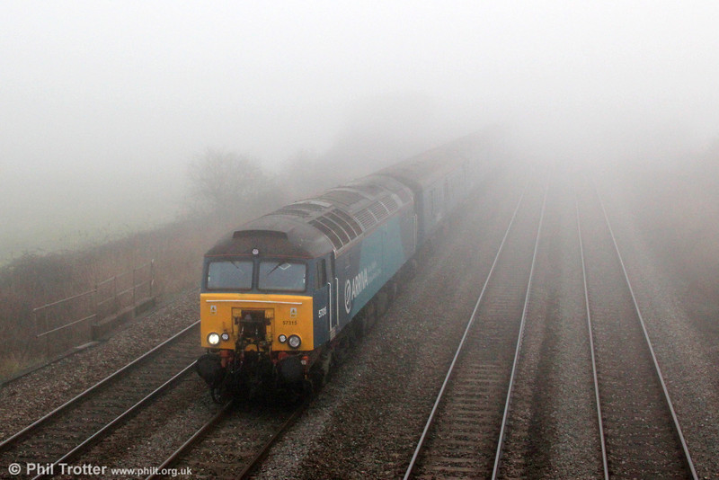 57315 emerges from the dense fog at Coedkernew with 1V31, 0532 Holyhead to Cardiff Central on 1st March 2012.