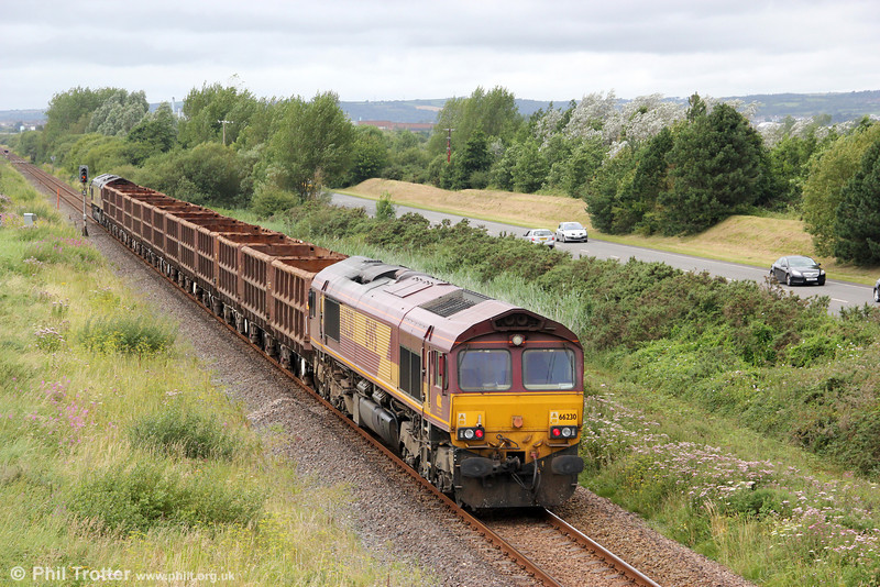 66230 brings up the rear of 6Z42, 1200 Margam to Trostre empty SSA scrap wagons at Loughor on 12th August 2012.